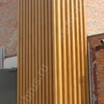 Отделка фасада здания клееным брусом
