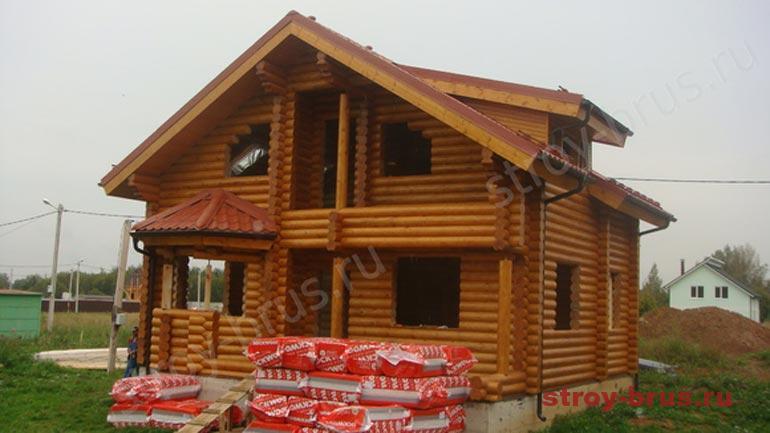 Пример покраски фасада дома из дерева