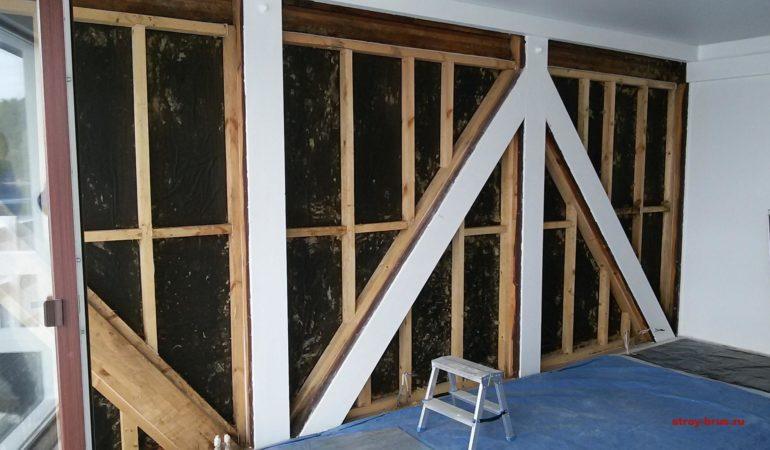 Демонтаж внутренней облицовки и утепления стены из клееного бруса